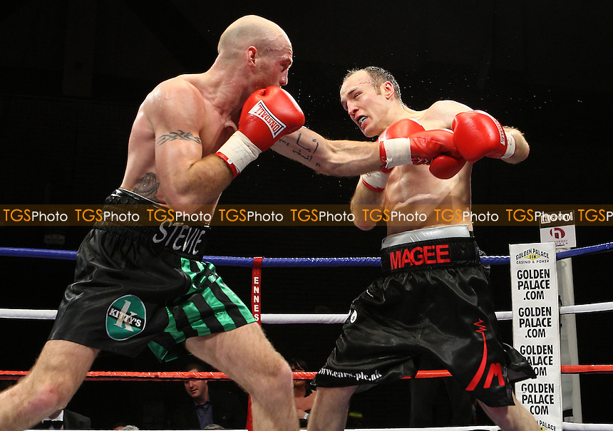 Brian Magee (Belfast, black shorts) defeats Stevie McGuire (Glenrothes, black/green shorts) in a Super-Middleweight boxing contest for the British Title at the Brentwood Centre, Essex promoted by Hennessy Sports -  13/12/08 - MANDATORY CREDIT: Gavin Ellis/TGSPHOTO - Self billing applies where appropriate - Tel: 0845 094 6026