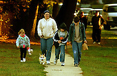 """Bowie, MD - October 23, 2002 -- Unidentified parent walks her kids to Benjamin Tasker Middle School.  There were few students observed walking to school due to the fears surrounding the """"Beltway Sniper"""".  Tasker is where an unidentified 13 year-old boy was shot on October 7, 2002.<br /> Credit: Ron Sachs / CNP<br /> (RESTRICTION: NO New York or New Jersey Newspapers or newspapers within a 75 mile radius of New York City)"""