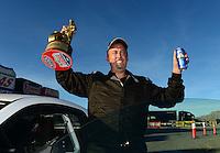 Oct. 28, 2012; Las Vegas, NV, USA: NHRA stock eliminator driver Bo Butner celebrates after winning the Big O Tires Nationals at The Strip in Las Vegas. Mandatory Credit: Mark J. Rebilas-