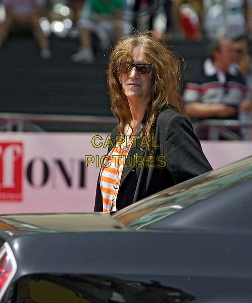 Patti Smith.attends 2012 Giffoni Film Festival, Giffoni Valle Piana, Italy. .July 19th, 2012.half length black jacket white orange striped stripes top sunglasses shades side .CAP/IPP.©IPP/Capital Pictures.
