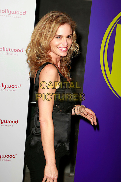BETSY RUSSELL.Planet Hollywood Resort & Casino Grand Opening - Day 2.held at the Planet Hollywood Resort & Casino, Las Vegas, Nevada, USA..November 17th, 2007.half length black satin silk top camisole hand.CAP/ADM/MJT.©MJT/AdMedia/Capital Pictures.