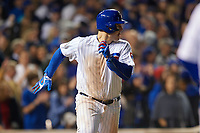 Chicago Cubs Anthony Rizzo (44) runs to first base after hitting a single in the ninth inning during Game 3 of the Major League Baseball World Series against the Cleveland Indians on October 28, 2016 at Wrigley Field in Chicago, Illinois.  (Mike Janes/Four Seam Images)