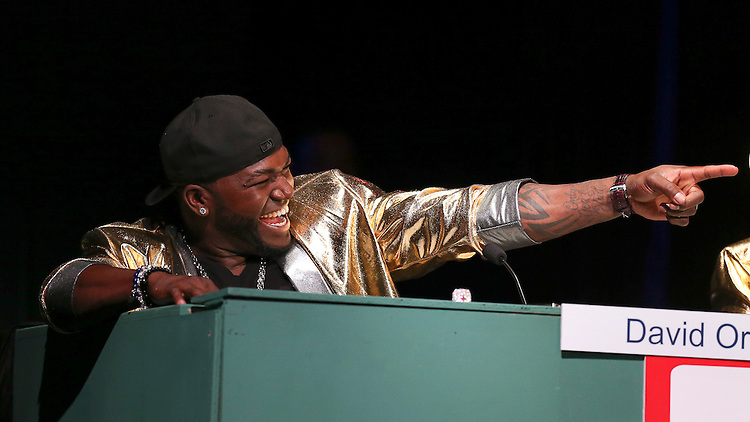 """Boston Red Sox designated hitter David Ortiz laughs and points during the Match Game at the Red Sox Foundation's annual """"Welcome Home Party,"""" a fundraiser to benefit the Foundation's programs for the families of New England at the House of Blues in Boston on Friday, April 4, 2014. (Brita Meng Outzen/Boston Red Sox)"""