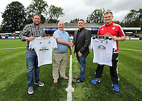 Pictured: Academy Manager Nigel Rees (3rd L) and Merthyr's chief executive, Rob Price (2nd L), on the pitch following the partnership between the two clubs Saturday 11 July 2015<br />