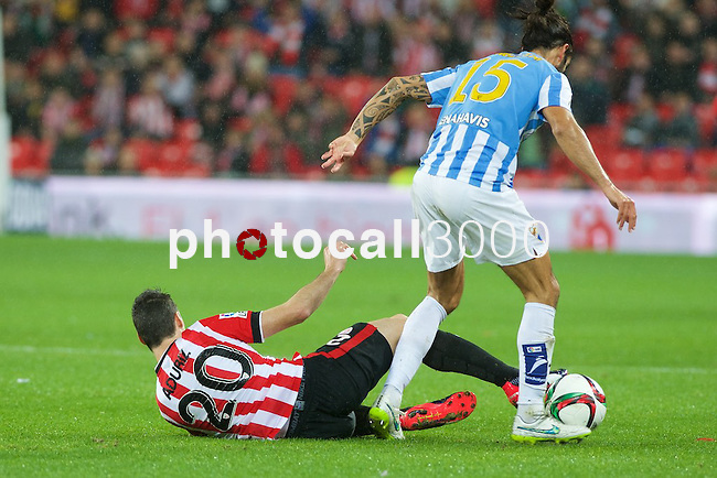 Football match during La Copa del rey, between the teams Athletic Club and Malaga CF<br /> Bilbao, 30-01-14<br /> aduriz fighting for the ball with angeleri<br /> Rafa Marrodán&Alex Zugaza/PHOTOCALL3000
