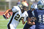 Torrance, CA 09/08/11 - Issac Kuo (Peninsula #28) and an unidentified North player in action during the North-Peninsula Junior Varsity Football game at North High School in Torrance.