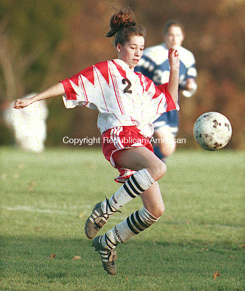 SOUTHBURY,CT. 11/2/98--1102SV04.tif--#2 Trisha Breault of Pomperaug  sends a ball down field  against Nonnewaug during a soccer match up in Southbury on Monday. Steven Valenti Photo