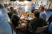 NWA Democrat-Gazette/DAVID GOTTSCHALK  Jim Zalenski (second from left), vice president of Rugged Faith Ministries, enjoys a meal Thursday, October 22, 2015, during fellowship at Rugged Faith in Tontitown.