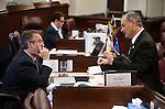 Nevada Senate Republicans Mark Lipparelli, left, and James Settelmeyer work on the Senate floor at the Legislative Building in Carson City, Nev., on Friday, April 3, 2015. <br /> Photo by Cathleen Allison