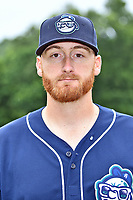 Asheville Tourists pitcher Heath Holder (26) before a game against the Rome Braves at McCormick Field on June 25, 2017 in Asheville, North Carolina. The Braves defeated the Tourists 7-2. (Tony Farlow/Four Seam Images)