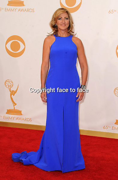 Edie Falco arrives at the 65th Primetime Emmy Awards at Nokia Theatre on Sunday Sept. 22, 2013, in Los Angeles.<br />