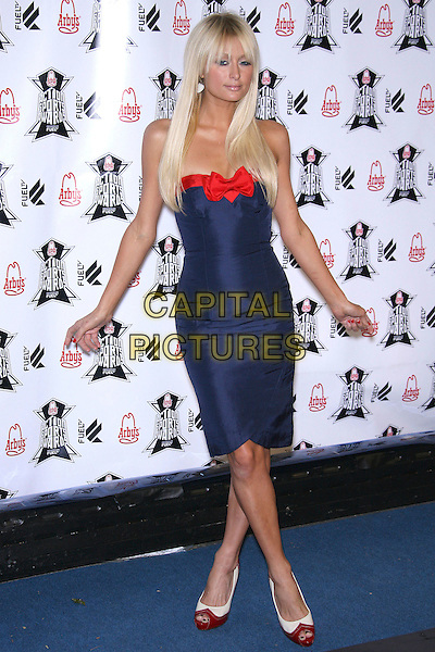 PARIS HILTON.Arby's Action Sports Awards - Arrivals,.held at Center Staging, Burbank, California, .USA, 30 November 2006..full length fringe straight hair extensions strapless red and blue bow dress hands arms .CAP/ADM/ZL.©Zach Lipp/AdMedia/Capital Pictures.