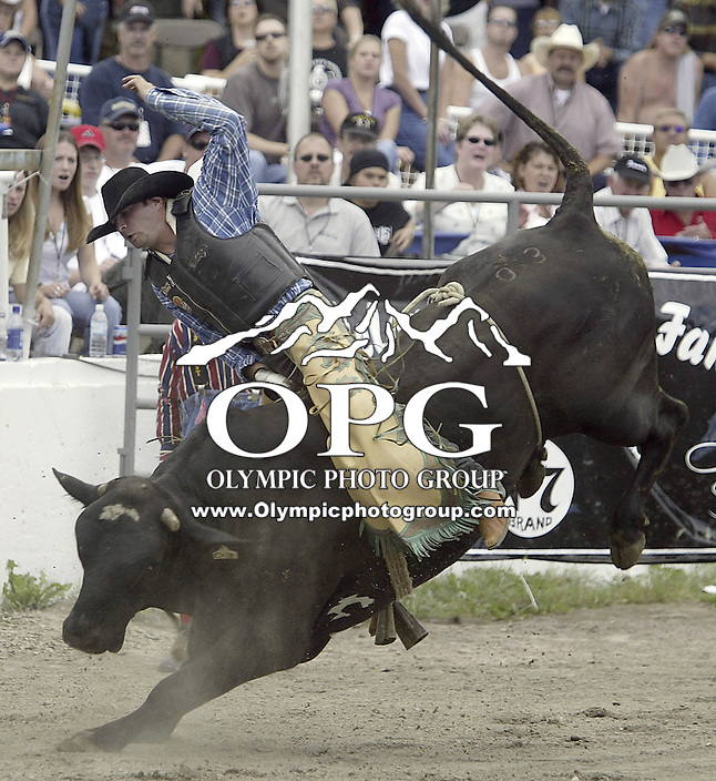 "29 August, 2004: PRCA Rodeo Bull Rider Shad Bruhn riding the bull ""Black Smoke"" during the PRCA 2004 Extreme Bulls competition in Bremerton, WA."