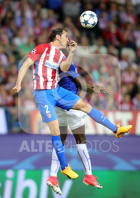 Atletico de Madrid's Diego Godin (l) and Leicester City FC's Wilfred Ndidi during Champions League 2016/2017 Quarter-finals 1st leg match. April 12,2017. (ALTERPHOTOS/Acero)