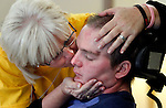 """""""I love you,"""" Candi Diercks says to her son, Matt, 30,  while planting a kiss on his cheek while he rests before one of his therapy sessions at On With Life, a brain injury rehabilitation center in Ankeny.  Matt was injured in a motorcycle accident in July and has been rehabbing at On With Life since October.  Matt can't speak yet, but responds to his mother's kiss by opening and closing his jaw and an occasional moan.  Candi and her husband, Jeff, moved to Ankeny from Sabula to be near Matt while he recovers."""