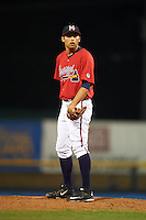 Mississippi Braves pitcher Jorge Reyes (23) looks in for the sign during a game against the Pensacola Blue Wahoos on May 28, 2015 at Trustmark Park in Pearl, Mississippi.  Mississippi defeated Pensacola 4-2.  (Mike Janes/Four Seam Images)