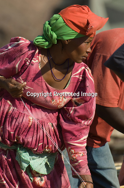 Herero women wear very distinctive long flowing Victorian gowns, with multiple overlapping petticoats, and headdresses. Victorian missionaries, shocked by the near nakedness that they found among the Herero, introduced this style of dress and, astonishingly in view of temperatures in Namibia, it has survived.