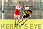 Ambrose O'Donovan Dr Crokes in action against Tom O'Sullivan Dingle in the Senior County Football Semi Final in Fitzgerald Stadium on Sunday.