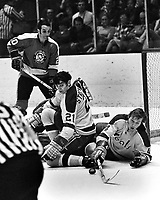 Seals vs Penguins: Ron Stackhouse, and Dick Redmond.in front of the net, penguin Dean Prentice..(photo/Ron Riesterer)