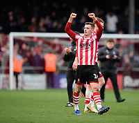 Lincoln City's Harry Toffolo celebrates at the end of the game<br /> <br /> Photographer Chris Vaughan/CameraSport<br /> <br /> The EFL Sky Bet League Two - Lincoln City v Grimsby Town - Saturday 19 January 2019 - Sincil Bank - Lincoln<br /> <br /> World Copyright © 2019 CameraSport. All rights reserved. 43 Linden Ave. Countesthorpe. Leicester. England. LE8 5PG - Tel: +44 (0) 116 277 4147 - admin@camerasport.com - www.camerasport.com
