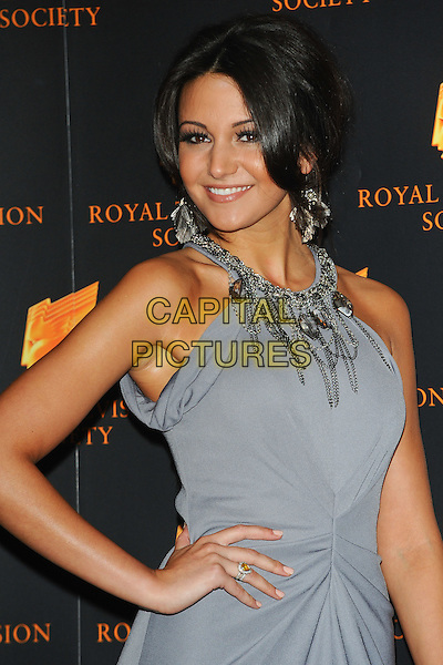 MICHELLE KEEGAN.The Royal Television Society (RTS) Awards, Grosvenor House Hotel, Park Lane, London, England, UK,.March 15th 2011..half length grey gray blue dress chains make-up side ponytail hair beauty sleeveless hand on hip tanned fake tan .CAP/CJ.©Chris Joseph/Capital Pictures.