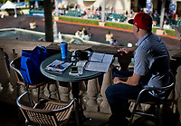 HALLANDALE BEACH, FL - JANUARY 27: A man handicaps the races and overlooks the paddock on Pegasus World Cup Invitational Day at Gulfstream Park Race Track on January 27, 2018 in Hallandale Beach, Florida. (Photo by Scott Serio/Eclipse Sportswire/Getty Images)
