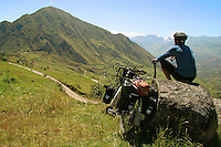 A long distance cyclist takes a rest at 12,000 ft. - Pan American Highway - Ecuador