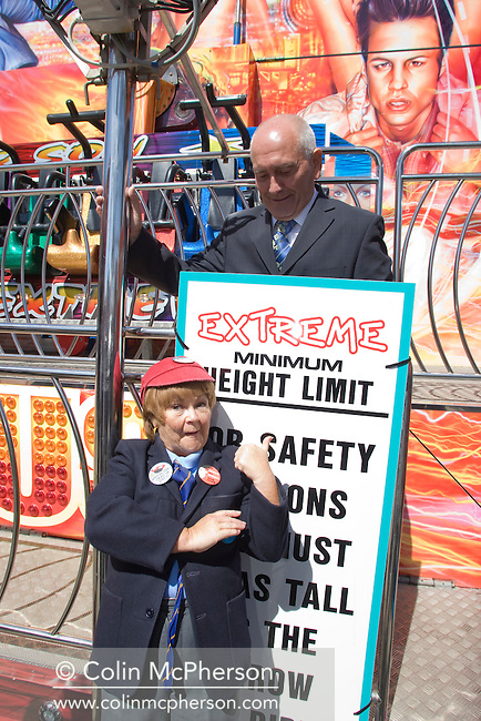 Wee Jimmy Krankie pictured with Tommy Cannon on a fairground ride on the Central Pier in Blackpool. The veteran comedienne and entertainer was promoting her forthcoming show entitled the Best of British Variety Tour 2008, which also featured Frank Carson, Cannon & Ball, Paul Daniels, Brotherhood of Man and Jimmy Cricket. The Krankies comprised husband and wife Janette and Ian Tough and portrayed schoolboy Wee Jimmy Krankie (Janette), and Jimmy's father (Ian), though in their comedy act they also portray other characters.