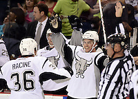 San Antonio Rampage players celebrate the win after an AHL hockey game against the Rockford IceHogs, Saturday, Oct. 5, 2013, in San Antonio. San Antonio won 3-1. (Darren Abate/M3D14.com)