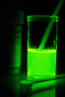 LUMINESCENCE CAUSED BY CHEMICAL REACTION<br /> Reaction Of Luminol And Sodium Perborate In Beaker<br /> Luminescence or cool light is caused by the movement of electrons within a substance from more energetic states to less energetic states.