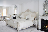 In the master bedroom the massive double bed is situated between a matching pair of marble fireplaces in the style of an 18th century chateau