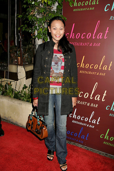 "CASSANDRA HEPBURN.Launch party for the new book ""Dating, Mating, and Manhandling: The Ornithological Guide to Men""held Chocolat Restaurant and Bar, Los Angeles, California, USA..September 14th, 2006.Ref: ADM/RE.full length jeans denim jacket brown bag purse.www.capitalpictures.com.sales@capitalpictures.com.©Russ Elliot/AdMedia/Capital Pictures."