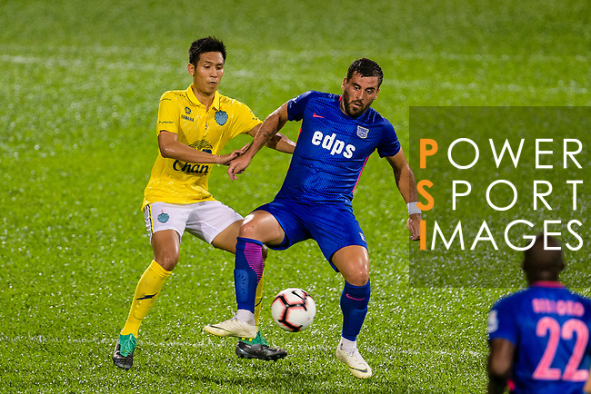 Lucas Espindola da Silva of Kitchee (R) fights for the ball with Chitipat Thanklang of Buriram (L) during the Preseason Friendly Match between Kitchee and Buriram United at Mong Kok Stadium on August 18, 2018 in Hong Kong. Photo by Marcio Machado/Photo by Marcio Machado/Power Sport Images