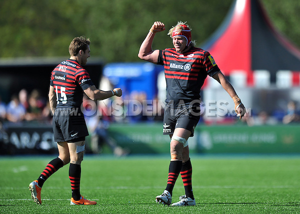 Mouritz Botha and Chris Wyles celebrate at the final whistle. Aviva Premiership match, between Saracens and Northampton Saints on April 13, 2014 at Allianz Park in London, England. Photo by: Patrick Khachfe / JMP