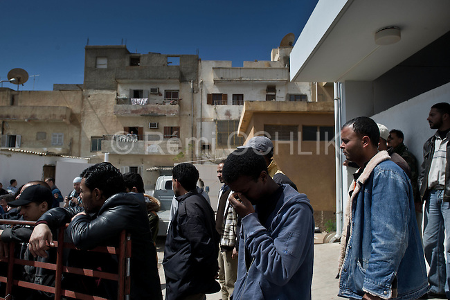© Remi OCHLIK/IP3 -   Benghazi  March 20, 2011 - Libyan men morn the dead at Benghazi hospital - At least 84 people, most of them are civilians , and had been killed in the Ghadafi air strike the day before.