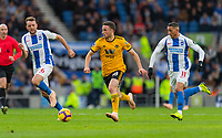 Wolverhampton Wanderers' Diogo Jota (centre) under pressure from Brighton &amp; Hove Albion's Dale Stephens (left) &amp; Anthony Knockaert (right) <br /> <br /> Photographer David Horton/CameraSport<br /> <br /> The Premier League - Brighton and Hove Albion v Wolverhampton Wanderers - Saturday 27th October 2018 - The Amex Stadium - Brighton<br /> <br /> World Copyright &copy; 2018 CameraSport. All rights reserved. 43 Linden Ave. Countesthorpe. Leicester. England. LE8 5PG - Tel: +44 (0) 116 277 4147 - admin@camerasport.com - www.camerasport.com
