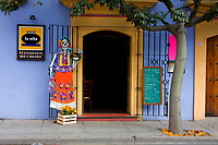 Oaxaca, Mexico, North America.  Day of the Dead Decorations.  La Olla Restaurant and Skeleton at Front Door.