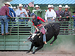 Amir Beardsley competes in the bull riding event at the Smackdown Tour at Fuji Park in Carson City, Nev., on Saturday, June 7, 2014.<br /> Photo by Cathleen Allison