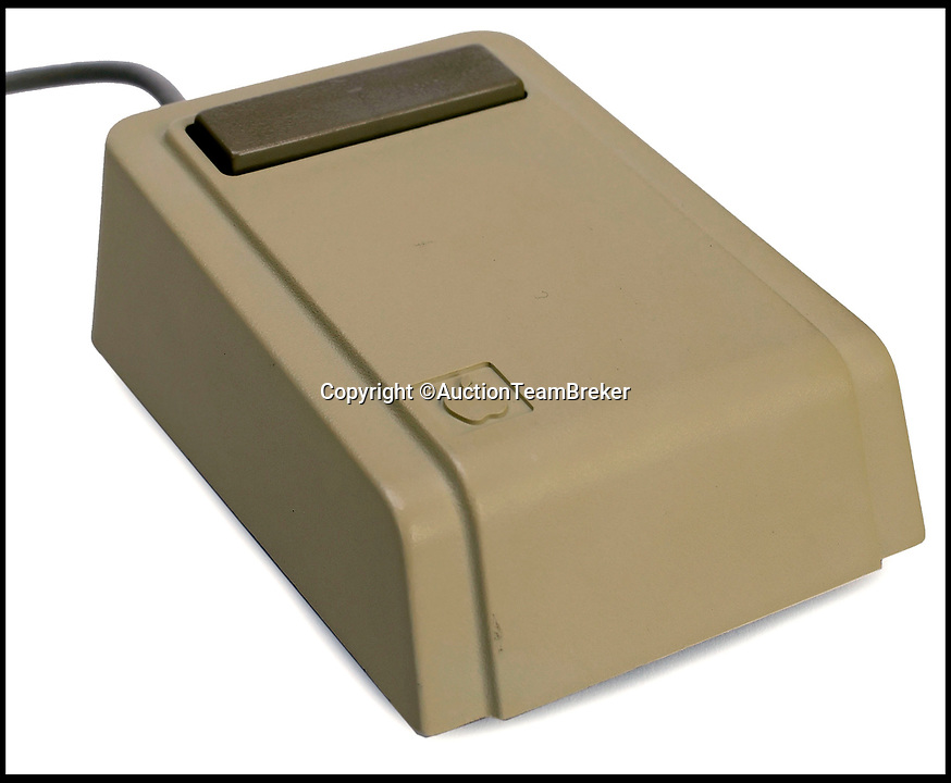 BNPS.co.uk (01202 558833)Pic: AuctionTeamBreker/BNPS<br /> <br /> The revolutionary mouse used with theb Apple Lisa 1.<br /> <br /> A rare surviving Apple computer that was the first to use a mouse has emerged for sale for £30,000.<br /> <br /> The Apple Lisa 1 machine was revolutionary as it was the first PC to allow users to interact with the device using the hand tool.<br /> <br /> It also used graphical icons instead of text and was the first time overlapping windows, pull-down menus and the drag and drop function appeared.<br /> <br /> The one now for sale in Germany belongs to a German university professor who was given it as a retirement present.