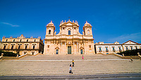 Panoramic photo of tourists at Noto Cathedral (Cattedrale di Noto), a Baroque building in Noto, Val di Noto, UNESCO World Heritage Site, Sicily, Italy, Europe. This is a panoramic photo of tourists at Noto Cathedral (Cattedrale di Noto), a Baroque building in Noto, Val di Noto, UNESCO World Heritage Site, Sicily, Italy, Europe.