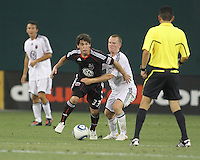 Martin Rivas #33 of D.C. United pulls away from Matthew Ritchie #3 of Portsmouth FC during an international friendly match at RFK Stadium on July 24 2010, in Washington D.C. United won 4-0.