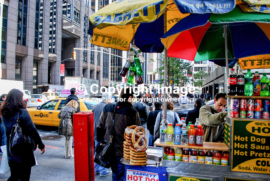 Street scene,street vendor, pedestrians, yellow cab, Manhatten, New York, USA, 201110215333..Copyright Image from Victor Patterson, 54 Dorchester Park, Belfast, United Kingdom, UK...For my Terms and Conditions of Use go to http://www.victorpatterson.com/Victor_Patterson/Terms_%26_Conditions.html