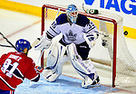 10 April 2010: Toronto Maple Leafs' goaltender Jean-Sebastien Giguere makes a second period save against the Montreal Canadiens at the Bell Centre in Montreal, Quebec, Canada. The Maple Leafs defeated the Canadiens 4-3 in sudden death overtime. Mandatory Credit: Ed Wolfstein Photo