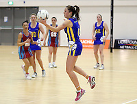 29.09.2014 Dunedin's Miaana Walden in action during the Dunedin v Kapi Mana match duing the Lion Foundation Netball Champs at the Trusts Stadium in Auckland. Mandatory Photo Credit ©Michael Bradley.