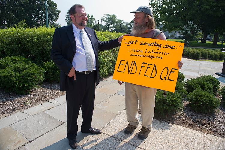 "UNITED STATES - AUGUST 02:  Rep. Steve LaTourette, R-Ohio, left, talks with Rick Hohensee after a news conference at the House Triangle where LaTourette and other House members called on Congress to work together to address a possible financial crisis in the future dubbed the ""fiscal cliff.""  Hohensee holds a sign he made which uses LaTourette quote from the news conference.  (Photo By Tom Williams/CQ Roll Call)"