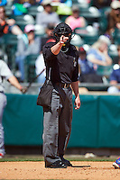Home plate umpire Ian Fazio makes a call during a game between the Louisville Bats and Buffalo Bisons on May 2, 2015 at Coca-Cola Field in Buffalo, New York.  Louisville defeated Buffalo 5-2.  (Mike Janes/Four Seam Images)