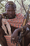 A Turkana man and his AK47 which he uses for protecting his family's herd.  AK 47's can be pruchased for around $50 - 100 dollars and are a popular possession in a region  deeply affected by  war and cattle raiding.