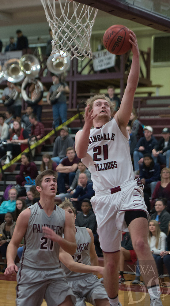 NWA Democrat-Gazette/J.T. WAMPLER Springdale's Kyler Mahar makes a lay-up in front of  Siloam Springs' Noah Karp Tuesday Jan. 5, 2016.