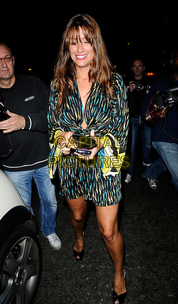 "REBECCA LOOS.UK Premiere of ""Daylight Robbery"", Apollo West End, London, England..August 27th, 2008.full length green print dress black yellow fringe hair extensions peep toe shoes long sleeves .CAP/CAN.©Can Nguyen/Capital Pictures."