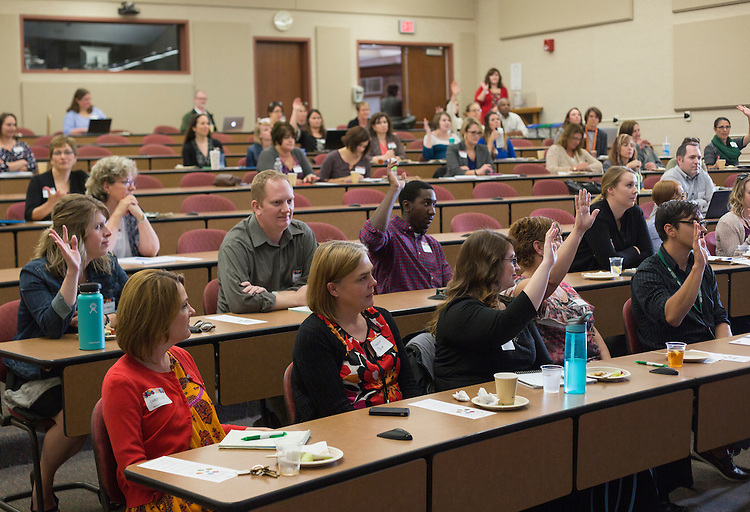 Attendees of the Marketing Symposium respond to a question asked by Dan Farkas, an instructor in Ohio University's Scripps College of Communication, during his presentation on November 2, 2016.